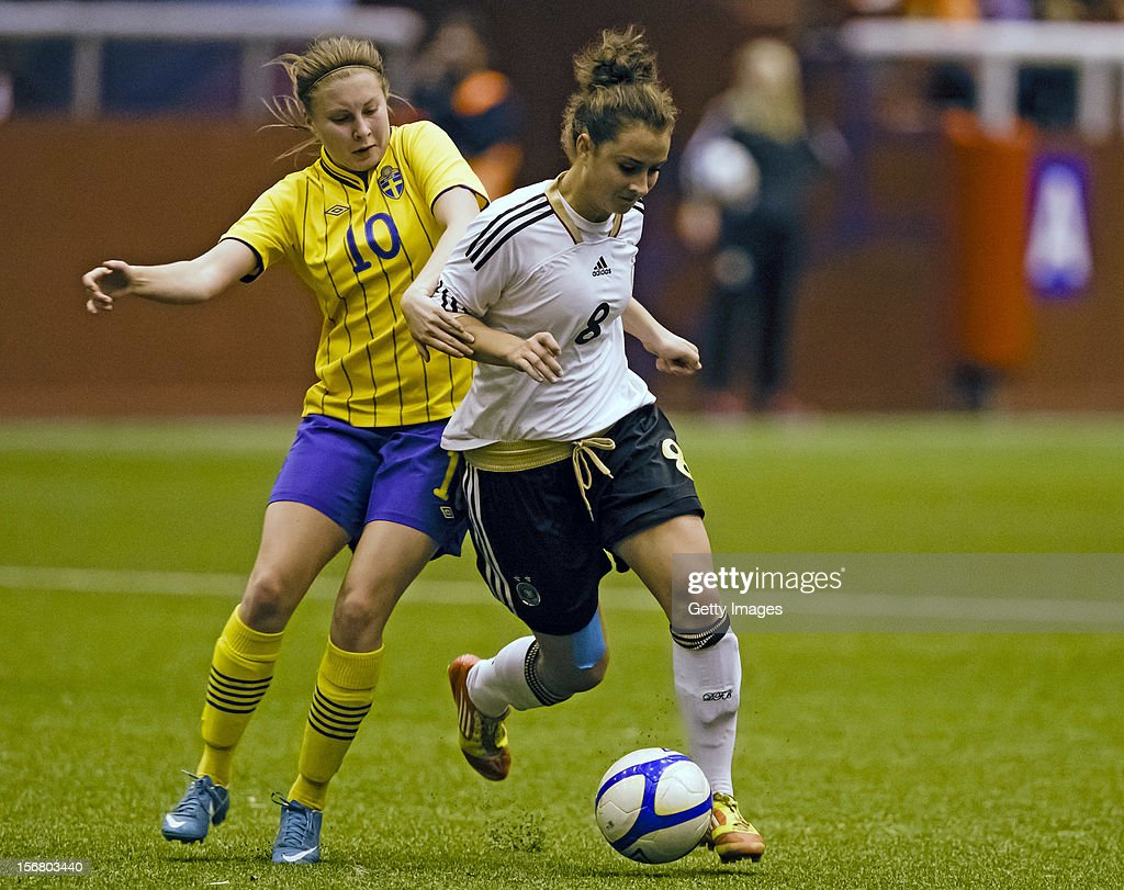 Fanny Andersson (L) of Sweden and Sara Dabritz of Germany fight for the ball during the Under 19 Women's international friendly between Sweden and Germany, at Tipshallen Stadium on November 21, 2012 in Vaxjo, Sweden.