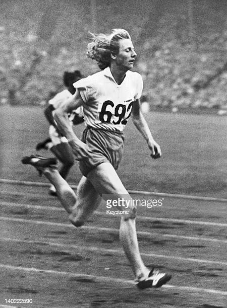 Fanny BlankersKoen of the Netherlands winning heat 1 of the women's 200 metres event at the Olympic Games Wembley Stadium London 5th August 1948...