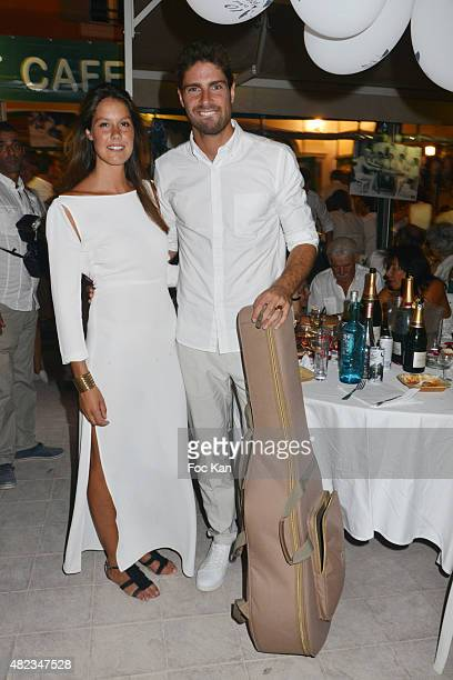 Fanny Leeb and Tom Leeb attend the Saint Tropez Tribute To Eddie Barclay Place Des Lices Saint Tropez on July 29 2015 in SaintTropez France