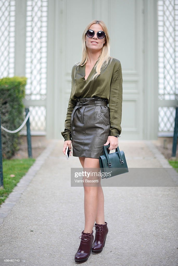 Fanny Massoutre poses wearing an Hermes total look on the streets of Paris during Paris Fashion Week on October 1 2014 in Paris France