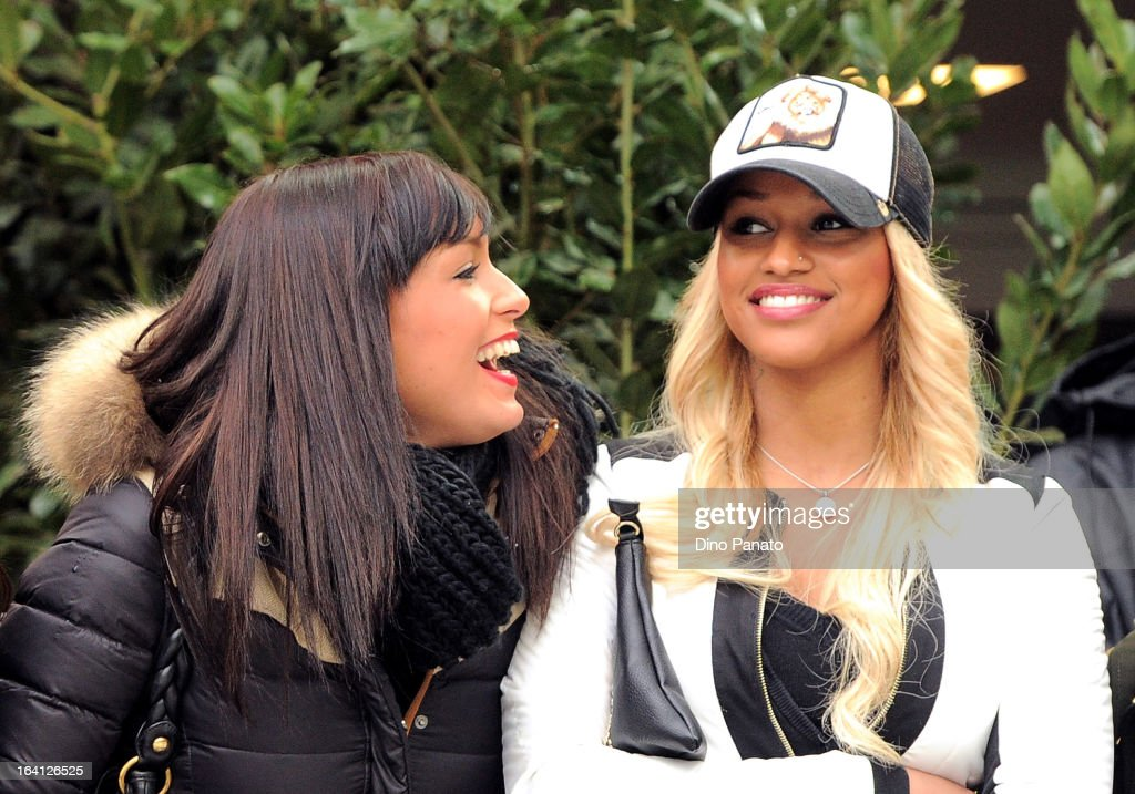 Fanny Neguesha (R) girlfriend of Balotelli attends during the Serie A match between AC Milan and US Citta di Palermo at San Siro Stadium on March 17, 2013 in Milan, Italy.