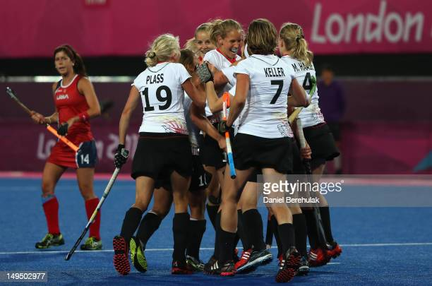 Fanny Rinne of Germany celebrates scoring the opening goal with her team mates during the Women's Hockey Pool WB Match W06 between Germany and the...