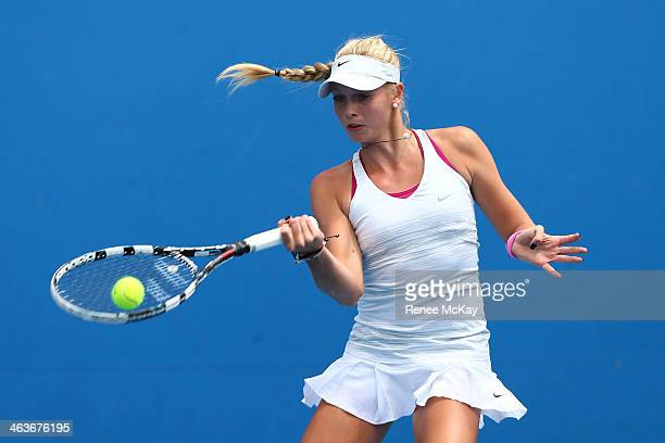 Fanny Stollar of Hungary plays a forehand in her first round junior girls' match against Rosie Cheng of New Zealand during the 2014 Australian Open...