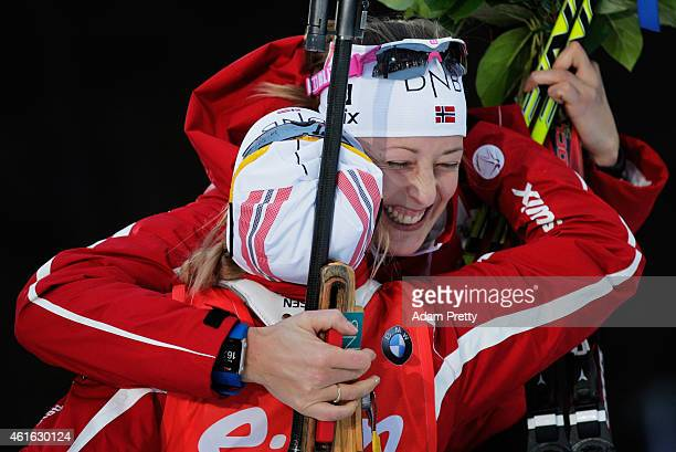 Fanny WelleStrand Horn of Norway celebrates with Tiril Eckhoff of Norway after victory in the IBU Biathlon World Cup Women's Sprint on January 16...