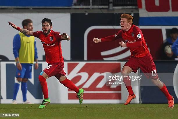 Fanol Perdedaj of Frankfurt celebrates his team's second goal with team mate Zsolt Kalmar during the Second Bundesliga match between 1 FC Heidenheim...