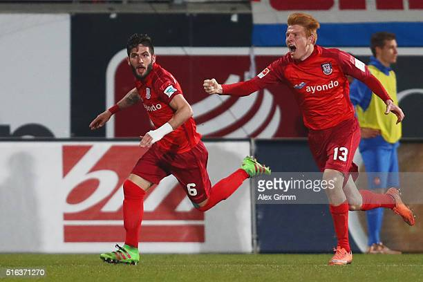 Fanol Perdedaj of Frankfurt celebrates his team's second goal with team mate Zsolt Kalmar during the Second Bundesliga match between 1 FC Heidenheim...