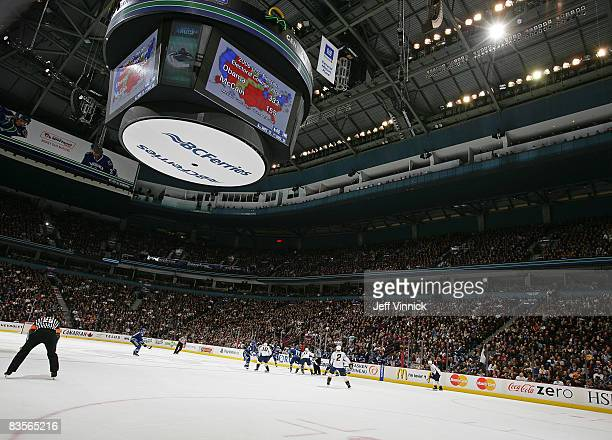 Fans a General Motors Place cheer as the results of the United States Presidential election are flashed on the scoreclock during the NHL game between...