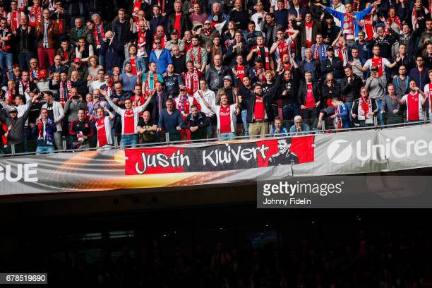 Fans Ajax with a banner for Justin Kluivert during the Uefa Europa League semi final first leg match between Ajax Amsterdam and Olympique Lyonnais at...