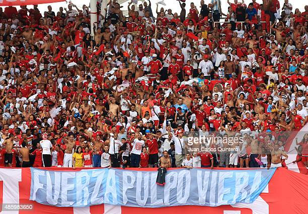 Fans America de Cali display a flag supporting Alexis Viera during a match between Depor FC and America de Cali as part of 8th round of second leg of...