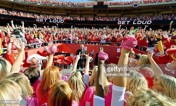 Fans and Kansas City Chiefs cheerleaders cheer as they surround the decibel meters in the end zone in the closing seconds of the fourth quarter...