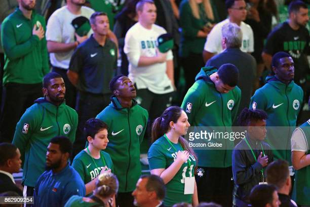 Fans and players are pictured as the national anthem is played before the start of the game The Boston Celtics host the Milwaukee Bucks in the team's...