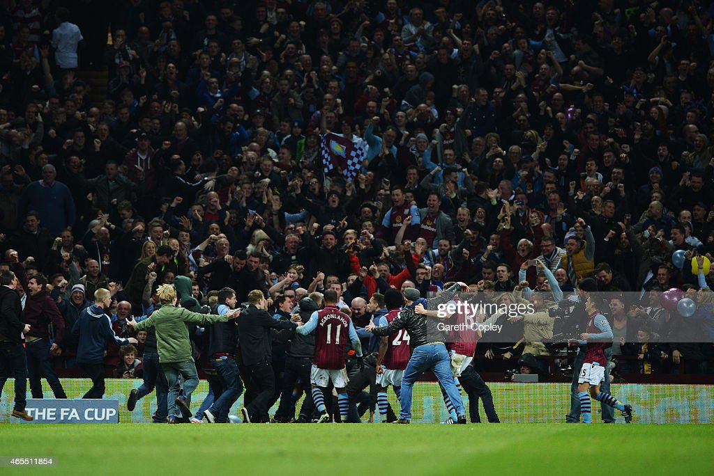 Fans and players celebrate as Scott Sinclair of Aston Villa scores their second goal during the FA Cup Quarter Final match between Aston Villa and West Bromwich Albion at Villa Park on March 7, 2015 in Birmingham, England.