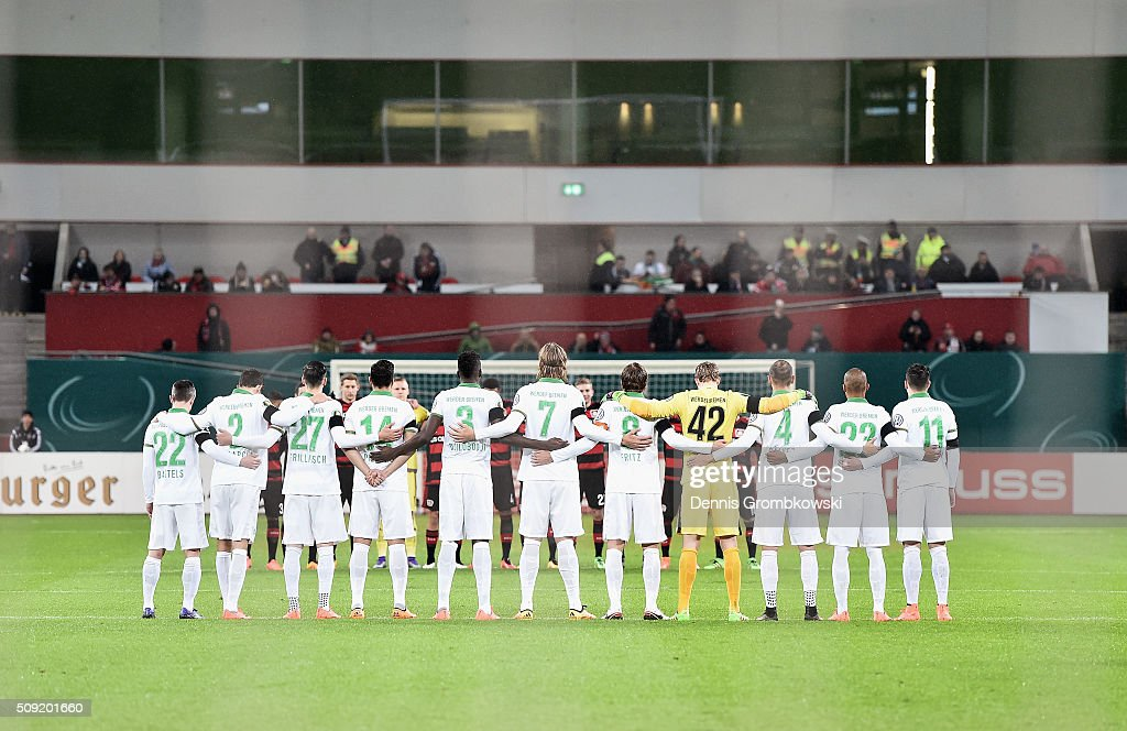 Fans and players observe a minutes silence to remember those who lost their lives in today's rail accident in Bavaria prior to the DFB Cup Quarter Final match between Bayer Leverkusen and Werder Bremen at BayArena on February 9, 2016 in Leverkusen, Germany.