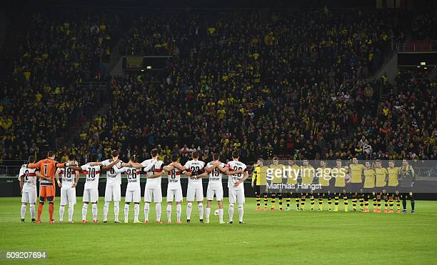 Fans and players observe a minutes silence to remember those who lost their lives in today's rail accident in Bavaria prior to the DFB Cup Quarter...