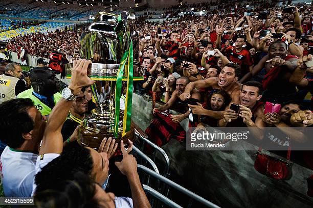 Fans and players of Flamengo celebrate the title against Atletico Paranaense after the final of Brazilian Cup 2013 between Flamengo and Atletico...