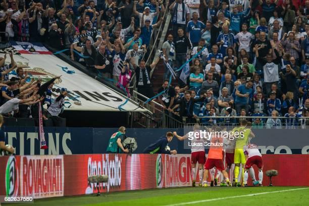 Fans and players of Hamburg celebrate the goal of PierreMichel Lasogga during the Bundesliga match between FC Schalke 04 and Hamburger SV at...