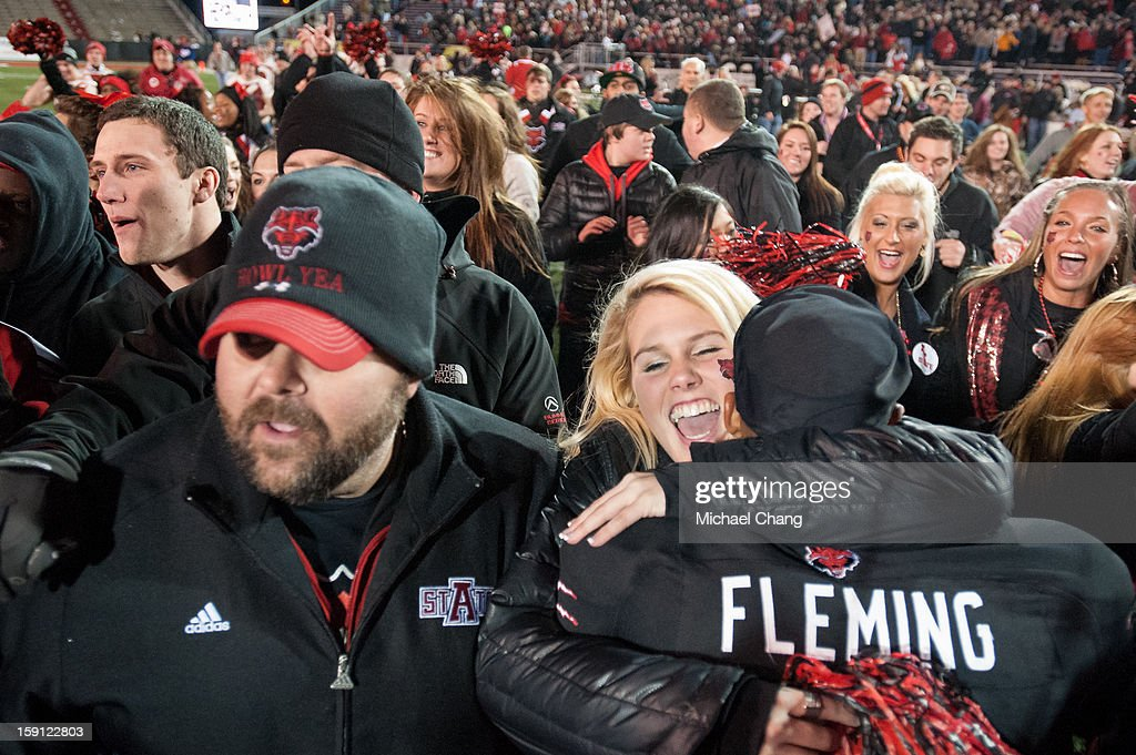 Fans and players of the Arkansas State Red Wolves celebrate after defeating the Kent State Golden Flashes on January 6, 2013 at Ladd-Peebles Stadium in Mobile, Alabama. Arkansas State defeated Kent State 17-13.