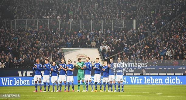 Fans and players remember former Wolfsburg player Junior Malanda recently died in a car crash prior to the Bundesliga match between FC Schalke 04 and...