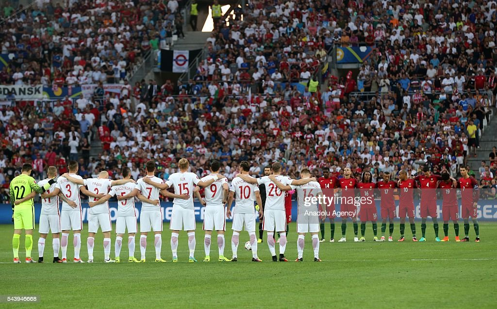 Fans and players stand in silence for the victims of the Istanbul Ataturk Airport terror attack, prior to the Euro 2016 quarter-final football match between Poland and Portugal at the Stade Velodrome in Marseille, France on June 30, 2016.