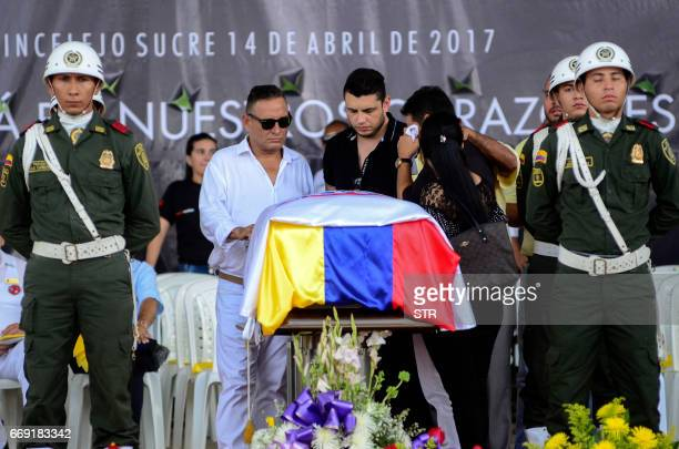 Fans and relatives of Colombian singer Martin Elias attend his funeral in Valledupar northern Colombia on April 16 2017 The singer/songwriter of...