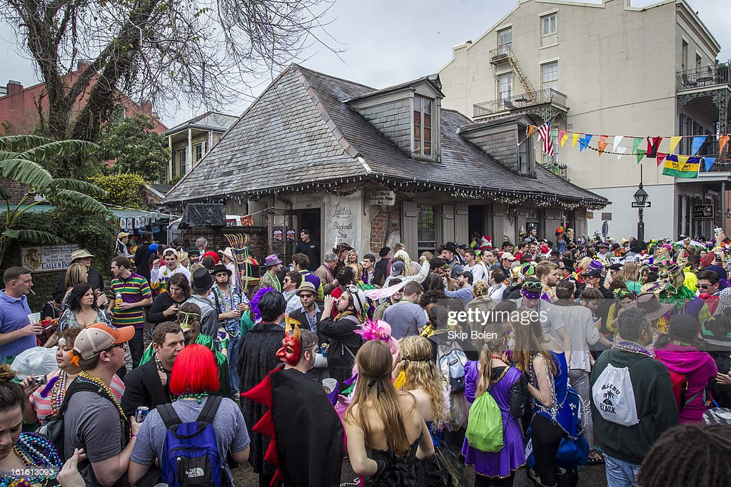 Fans and revelers outside Lafitte's Blacksmith Shop Bar on Bourbon Street in the historic French Quarter on Mardi Gras Day on February 12, 2013 in New Orleans, Louisiana.