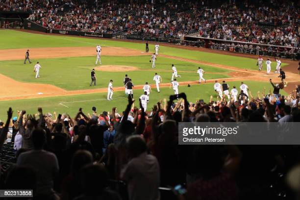 Fans and the Arizona Diamondbacks celebrate after Chris Herrmann hit a walk off RBI single against the St Louis Cardinals during the 10th inning of...
