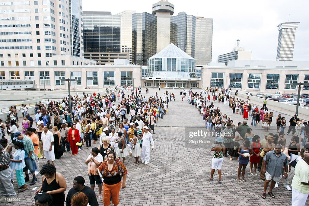Fans and ticket holders line up outside the refurbished Louisiana Superdome for the 13th Annual 2007 Essence Music Festival Unoccupied buildings in...