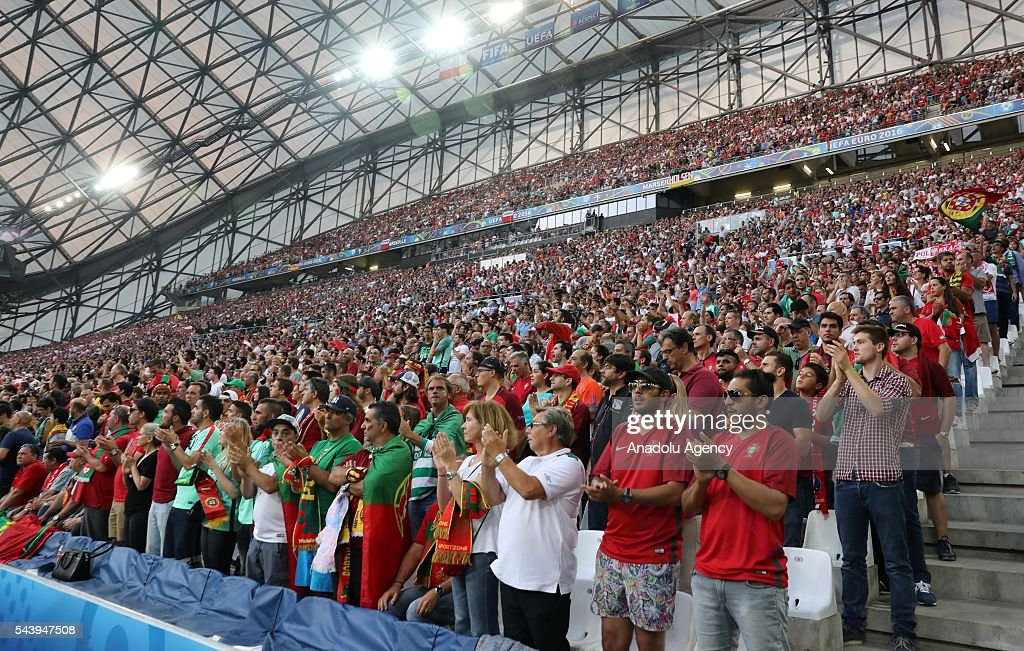 Fans applaud after standing in silence for the victims of the Istanbul Ataturk Airport terror attack, prior to the Euro 2016 quarter-final football match between Poland and Portugal at the Stade Velodrome in Marseille, France on June 30, 2016.