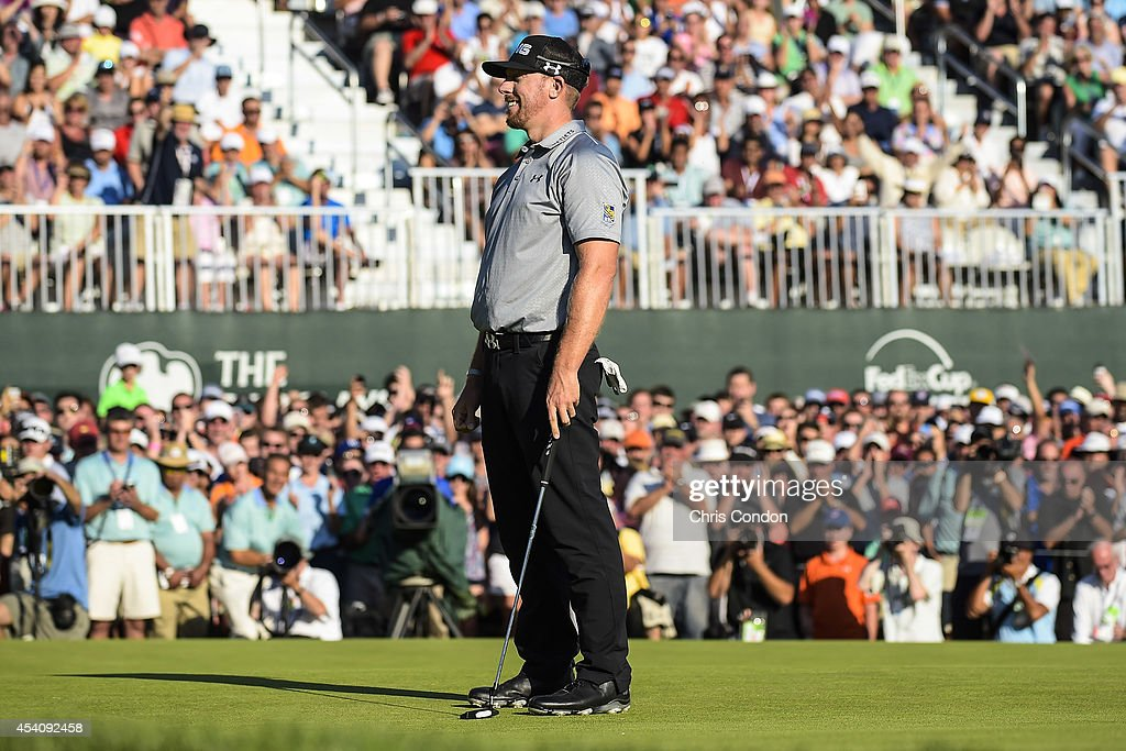 Fans applaud as <a gi-track='captionPersonalityLinkClicked' href=/galleries/search?phrase=Hunter+Mahan&family=editorial&specificpeople=885292 ng-click='$event.stopPropagation()'>Hunter Mahan</a> celebrates on the 18th hole green after making his putt and securing victory in the final round of The Barclays at Ridgewood Country Club on August 24, 2014 in Paramus, New Jersey.