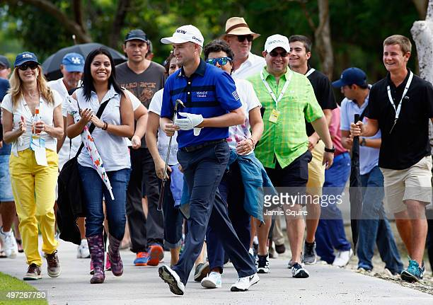 Fans applaud as Russell Knox of Scotland walks onto the fairway after hitting his second shot on the 6th hole during the final round of the OHL...