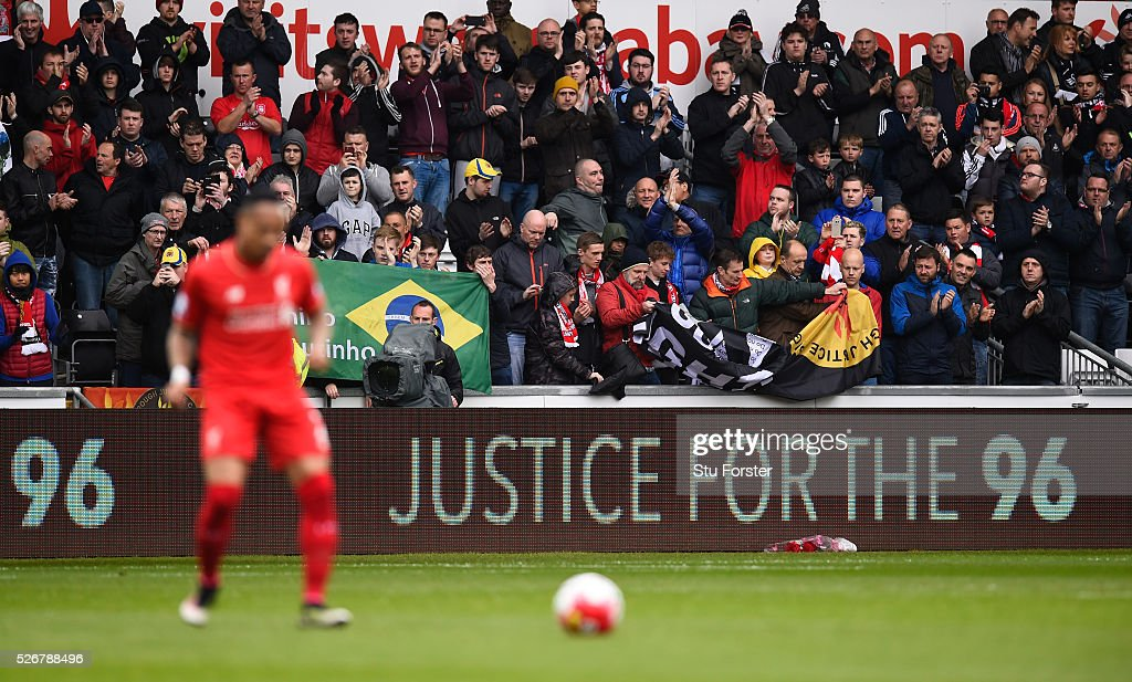 Fans applaud as they remember the 96 victims of the Hillsborough disaster during the Barclays Premier League match between Swansea City and Liverpool at The Liberty Stadium on May 1, 2016 in Swansea, Wales.