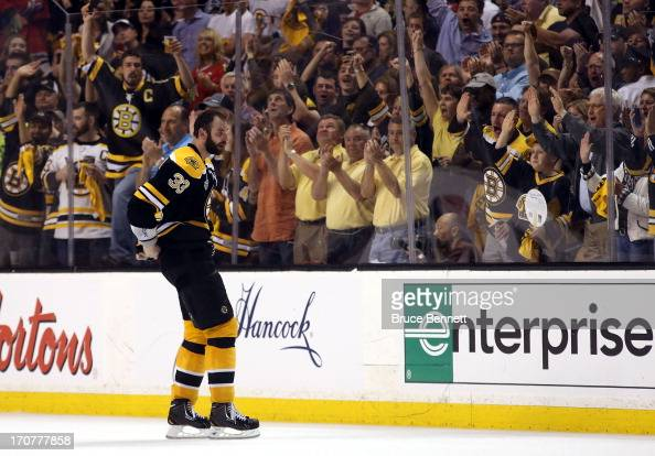 Fans applaud as Zdeno Chara of the Boston Bruins skates to the penalty box late in the game against the Chicago Blackhawks in Game Three of the 2013...