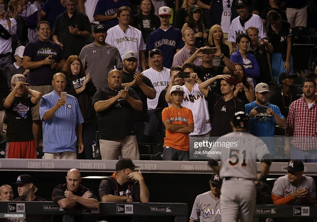 Fans applaud Ichiro Suzuki #51 of the Miami Marlins after his at bat in the ninth inning against the Colorado Rockies at Coors Field on August 6, 2016 in Denver, Colorado. Ichiro ground out, but got the 2,999th hit of his Major League Baseball career during his previous at bat.