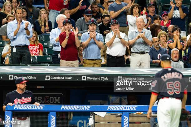 Fans applaud starting pitcher Carlos Carrasco of the Cleveland Indians as he leaves the game during the seventh inning against the Los Angeles Angels...