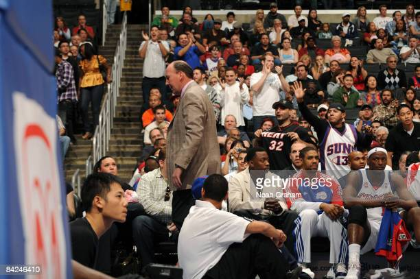 Fans applaud while Head Coach Mike Dunleavy of the Los Angeles Clippers leaves the court after being ejected during a game against the Phoenix Suns...