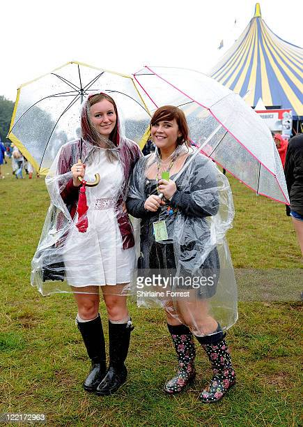 Fans are caught in the rain during Leeds Festival at Bramham Park on August 26 2011 in Leeds United Kingdom
