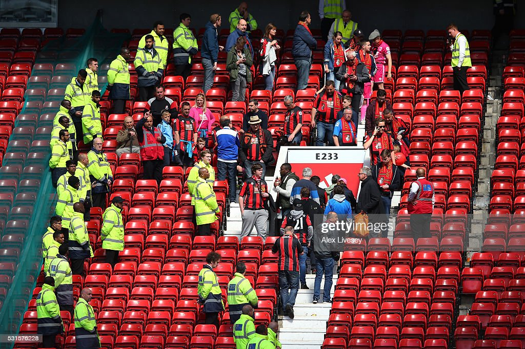Fans are evacuated from the ground as the match is abandoned ahead of the Barclays Premier League match between Manchester United and AFC Bournemouth...