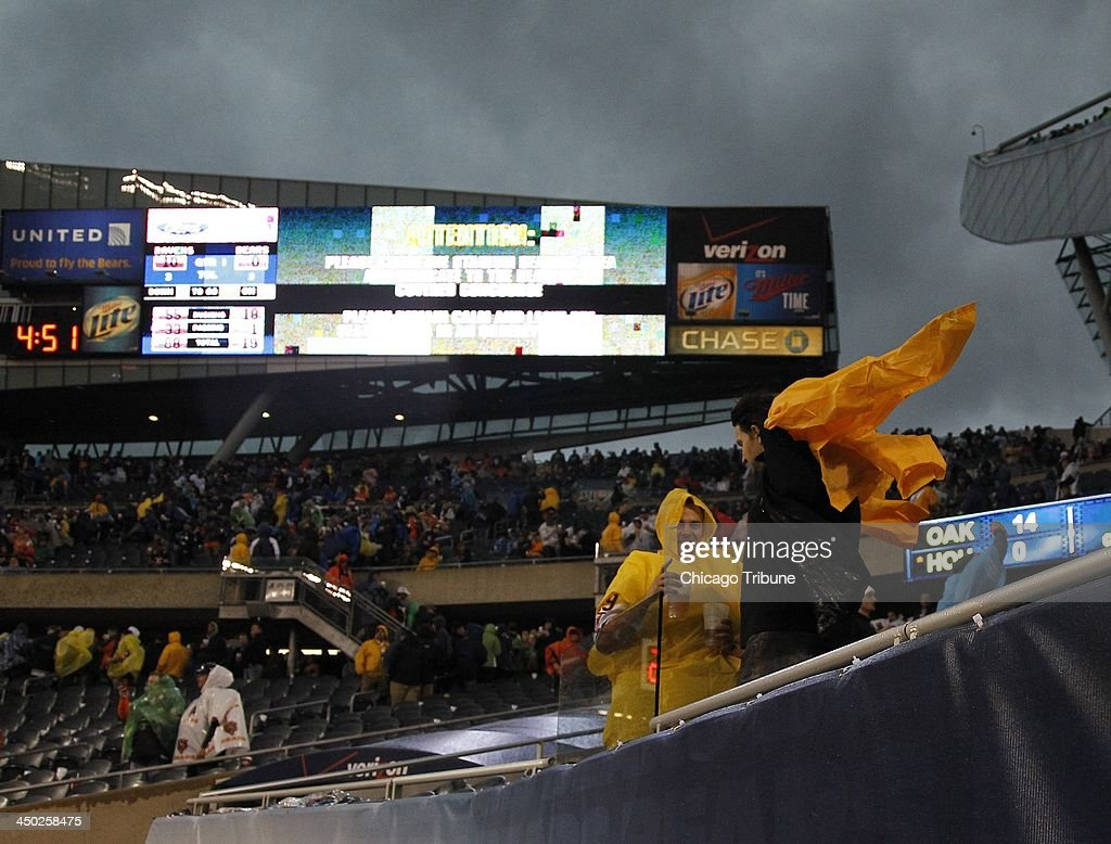 Fans are evacuated from the stadium due to a severe storm that stopped the Chicago Bears game against the Baltimore Ravens at Soldier Field in Chicago on Sunday, Nov. 17, 2013.