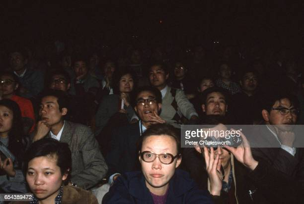 Fans are not impressed as they watch and listen to Wham including George Michael and Andrew Ridgeley playing a concert at Beijing's People's Stadium...