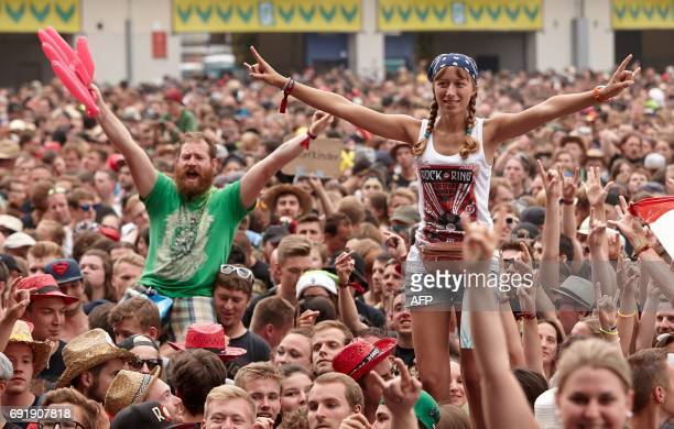 Fans are pictured during a performance of 'Broilers' group at the 'Rock am Ring' music festival on June 3 2017 in Nuerburg Germany's biggest rock...