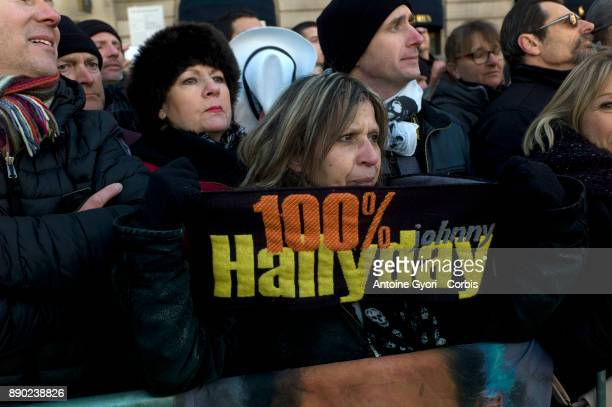 Fans are seen during Johnny Hallyday's funerals at Eglise De La Madeleine on December 9 2017 in Paris France France pays tribute to Johnny Hallyday...