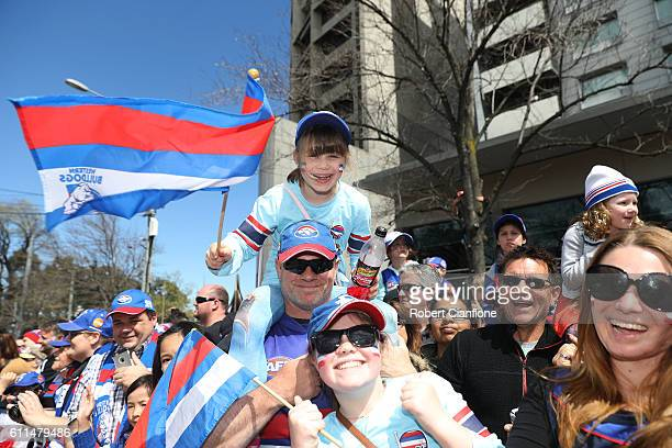Fans are seen during the 2016 AFL Grand Final Parade on September 30 2016 in Melbourne Australia