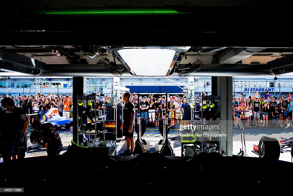 Fans are seen gathered in front of the Infiniti Red Bull Racing garage during previews for the German Formula One Grand Prix at Hockenheimring on July 17, 2014 in Hockenheim, Germany.