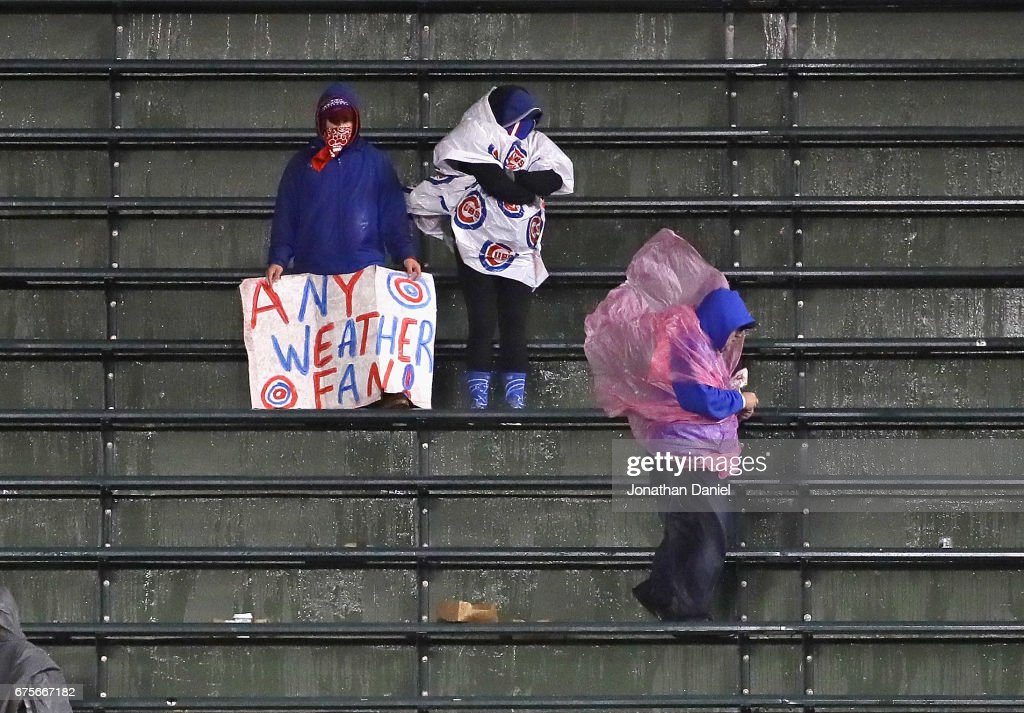 Fans are seen in the right field bleachers as it rains durng a game between the Philadelphia Phillies and the Chicago Cubs at Wrigley Field on May1, 2017 in Chicago, Illinois.