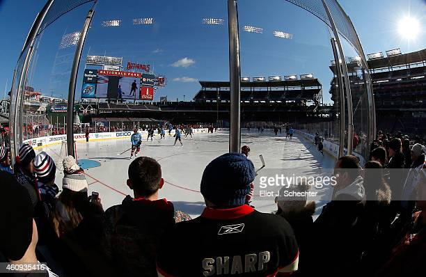 Fans are seen watching the Washington Capitals practice during practice day prior to the 2015 Bridgestone NHL Winter Classic on December 31 2014 in...