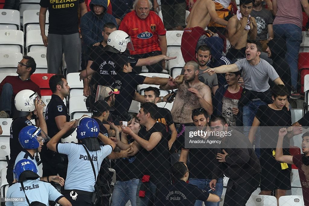 Fans argue with the police during the Ziraat Turkish Cup Final match between Galatasaray and Fenerbahce at Antalya Ataturk Stadium in Antalya, Turkey on May 26, 2016.