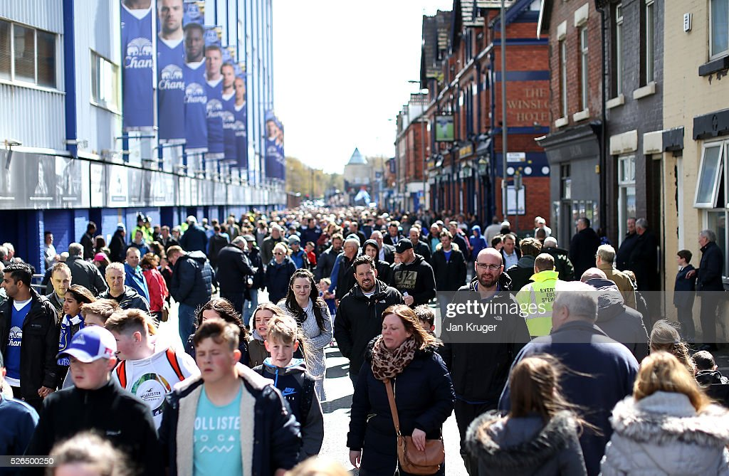 Fans arrive ahead of the Barclays Premier League match between Everton and A.F.C. Bournemouth at Goodison Park on April 30, 2016 in Liverpool, England.