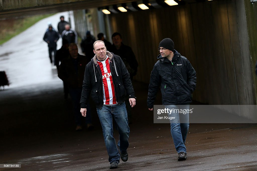Fans arrive ahead of the Barclays Premier League match between Stoke City and Everton at Brittania Stadium on February 06, 2015 in Stoke on Trent, England.