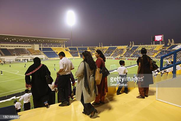Fans arrive at Al Gharafa Stadium to watch the Gharafa vs Kharaitiyat Qatar Stars League football match on October 23 2011 in Doha Qatar Qatar will...