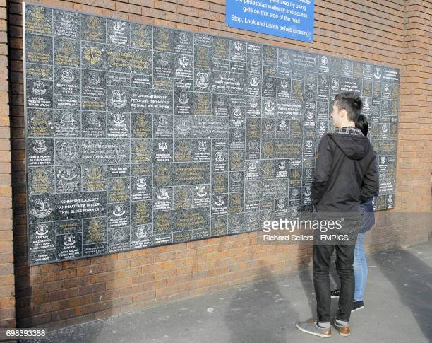 Fans arrive at Goodison Park in front of the Dixie Dean Wall of Fame